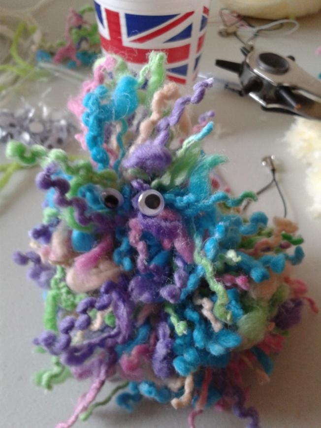 A multi-coloured pompom monster